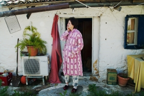 EVA, MESSINI, GREECE. 61-year-old widow, Ioanna Kapralou, crying outside her home. Ioanna is emblematic of deepening poverty in Greece following eight years of austerity. Her pension was cut this year from 430 euros to 250 euros a month, leaving her well beyond the poverty line and unable to pay her bills. Kapralou has respiratory problems, is blind from one eye and had a corneal detachment from the other. More than 40% of Greeks can't pay their electricity.